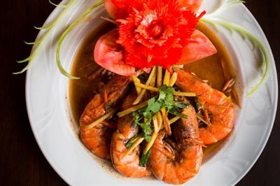 Prawn dish  garnished with a red flower